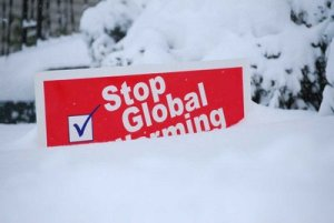 Stop_global_warming_sign_under_tons_of_snow1